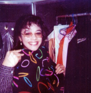 "Me in Prince's wardrobe with his ""All Around the World in One Day"" outfit."